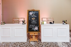 chalkboard bar sign for signature cocktails at wedding reception