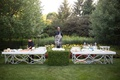 Outdoor backyard wedding with cocktail hour white silver bar ice sculputures boxwood hedge