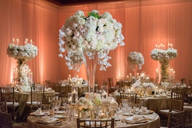 Wedding ballroom reception tall centerpieces flower sculpture white hydrangea blush rose orchids