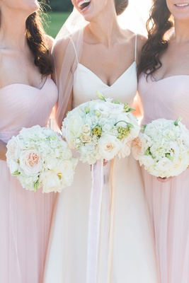 Bride in V-neck wedding dress amsale with bridesmaids in sweetheart neckline bridesmaid dresses