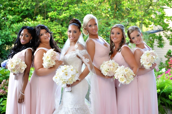 Pale pink Jim Hjelm bridesmaid dresses with Megan Wollover on wedding day in Ines Di Santo dress