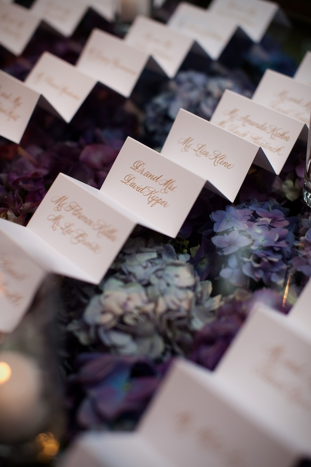 White place card with gold calligraphy lettering