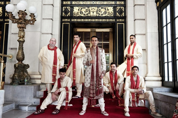 Men In Traditional Indian Attire Outside The Plaza