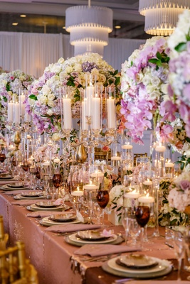 Wedding reception shimmer linen floating candles colored glassware candelabra crystal tall flowers