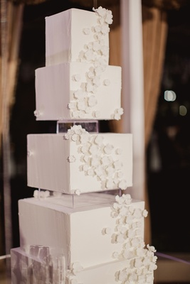 modern wedding cake with square tiers and cascading sugar flowers
