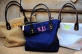 Tan, navy, and white tote bags with bridesmaid monograms