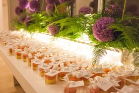 macaroon wedding favors, purple allium flowers and ferns