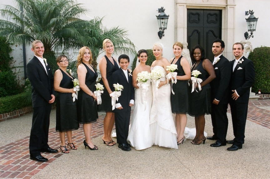 Gay wedding family portrait with two brides in dresses