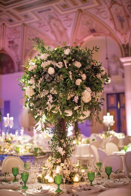 round wedding centerpieces with lots of greenery and white flowers