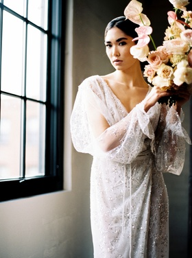 Bride in Galia Lahav wedding dress with sparkly beading star motif draped sleeves v neck bouquet