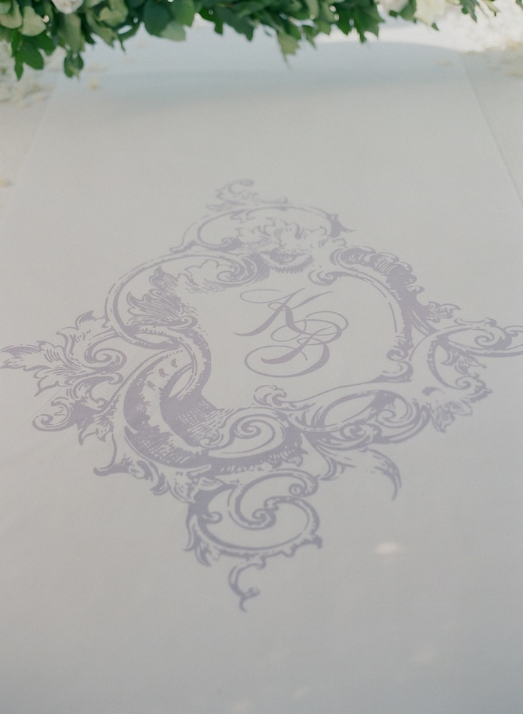 Lavender monogram on white aisle runner