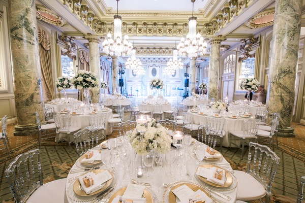 clear back chairs, white and gold reception decor, marble columns, white flower centerpieces