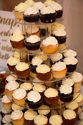 Lucite acrylic tower of vanilla and chocolate cupcakes on stand wedding reception dessert table