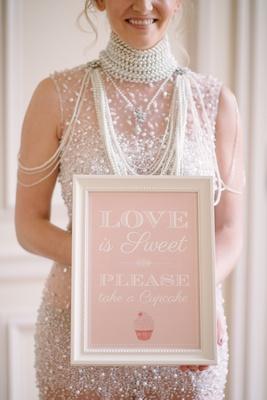 Pink sign for wedding dessert table