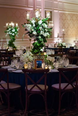 wedding reception forest theme wood vineyard chairs greenery white rose hydrangea candelabra gold
