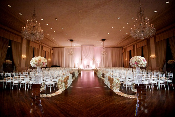 Ballroom wedding chicago wood floor flower petal wall aisle and arrangements chandeliers