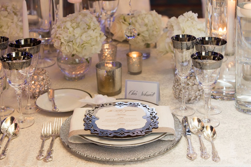 Wedding reception table silver charger plate and menu card rimmed glassware white hydrangea candles