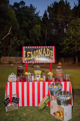 Lemonade stand and water bottles at circus theme outdoor wedding Malibu