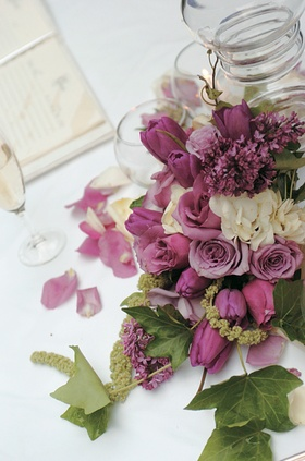 Purple, white, and green flower and leaf centerpiece