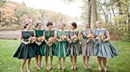 Bridesmaids in vintage-style dresses in different colors