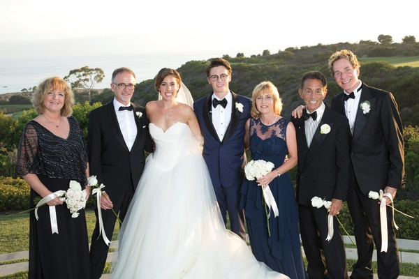 bride in vera wang ball gown, groom in navy tuxedo, newlyweds with parents, bride with two dads