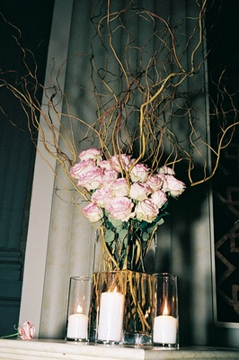 Pink roses and curly willow in vase