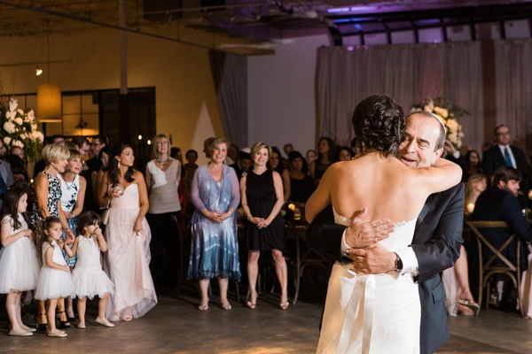 bride hugs her father and dances at wedding