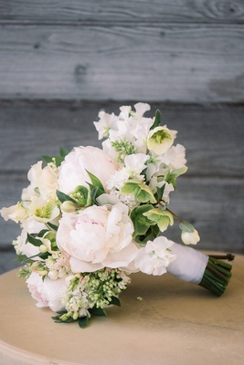 bridal bouquet with greenery, white flowers, white peonies with a hint of blush