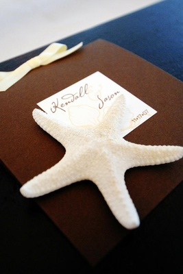 Beach wedding guest book with white star fish