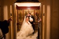 bride and groom kiss in elevator at the plaza hotel in new york city after wedding
