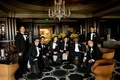 Groom with friends in tuxedos in swanky hotel