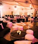 wedding reception ballroom for dancing black white lounge furniture gold metallic elements ottomans