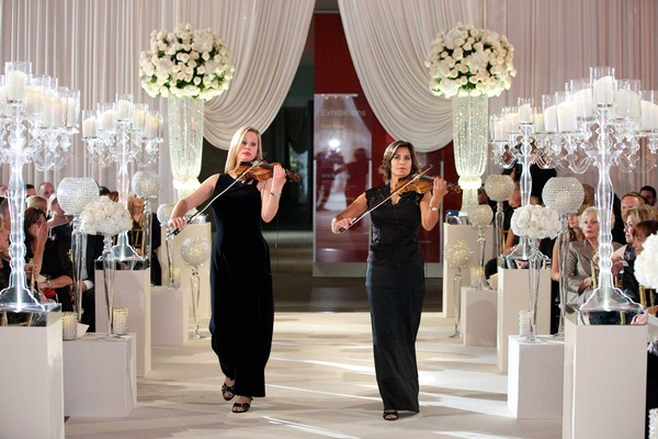 Chad Carroll and Jennifer Stone wedding entertainment violin players in black dresses walking aisle