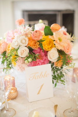 wedding table number gold card pink yellow orange flowers rose peony ranunculus greenery