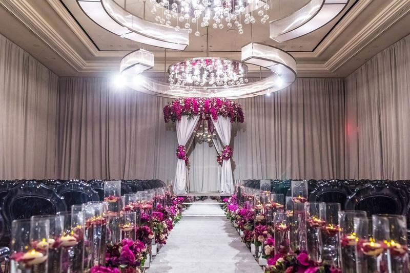 elegant las vegas wedding ceremony, fuchsia flowers, mirrored details, floating candles, grey chairs