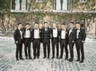 oheka castle wedding groom in tuxedo and vest with groomsmen in suits black bow ties boutonnieres