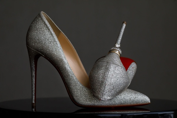 wedding rings on heel of christian louboutin pumps silver metallic red bottom sole shoes wedding