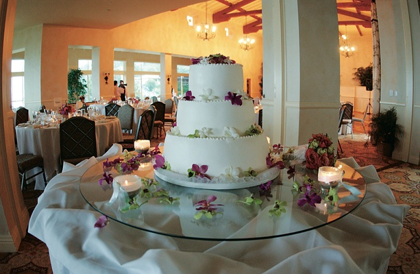 White round cake with three tiers and flowers