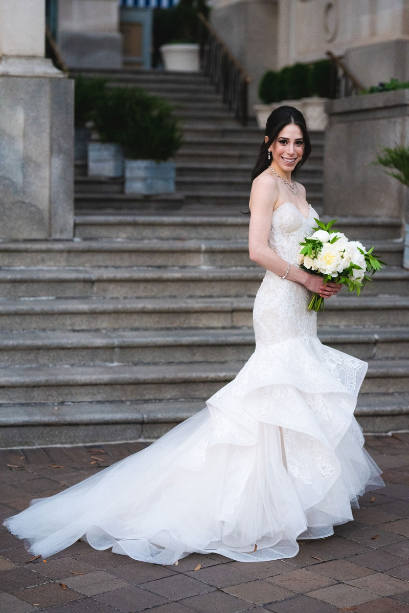 bride in low ponytail and strapless trumpet gown by monique lhuillier from carine's bridal atelier