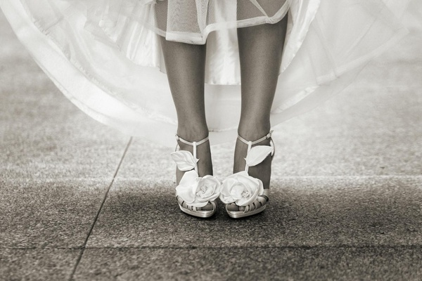 Black and white photo of bride wearing heels