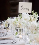 classic wedding reception white flower centerpiece table number seven modern calligraphy