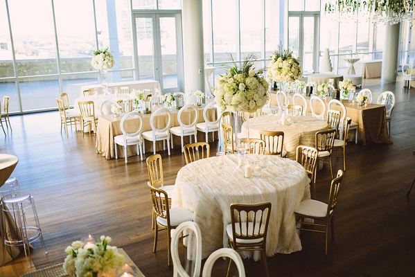 round and rectangular tables with different chair styles at the reception