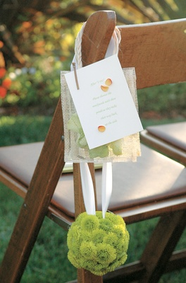 Balls of green mums were attached to bags of flower petals for guests to throw
