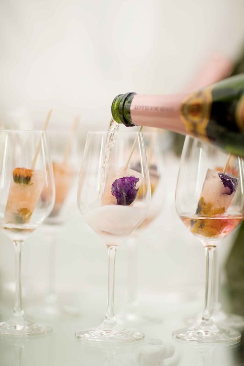 pink champagne poured over gourmet flower popsicles
