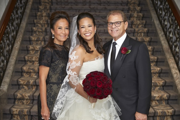 bride in vera wang wedding dress, mother of the bride in black lace carolina herrera