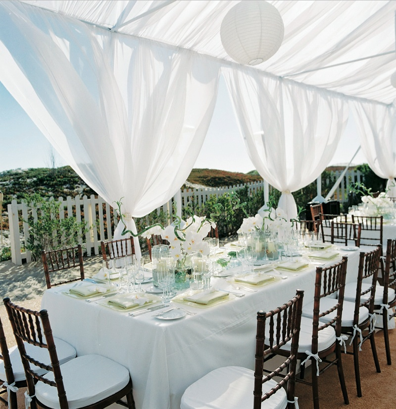 Outdoor reception with white tent on sand