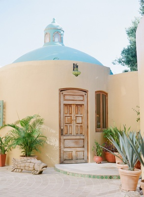 Wedding venue destination wedding in Riviera Nayarit, Mexico wood door adobe spanish style building
