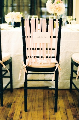 Black chair with pink ribbon