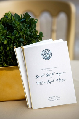 wedding programs for pakistani couple in white and gold with blue calligraphy