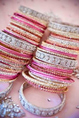 Pink, silver, and gold crystal-studded bracelets